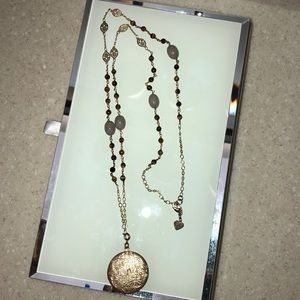 Long chain, beaded necklace with locket.